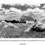 Hopefield church with wheat shocks in the foreground